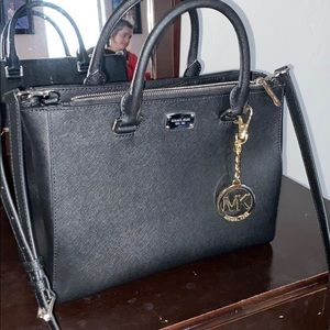 Black Michael Kors purse and matching wallet